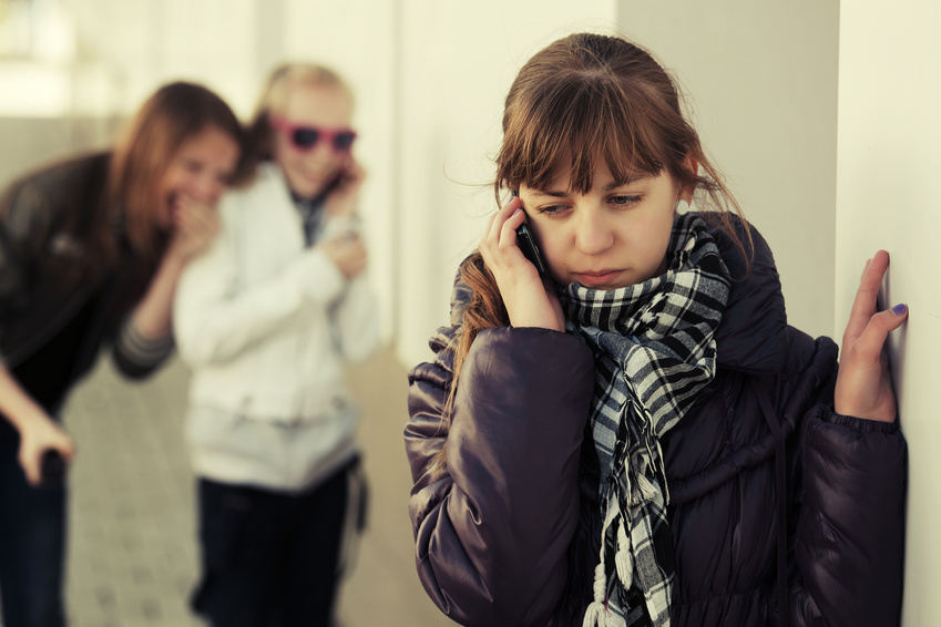 Teenage school girl calling on the cell phone