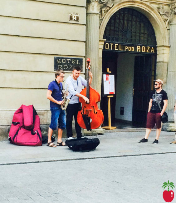 Musicians playing on the streets outside the Hotel Pod Roza in Krakow, Poland.