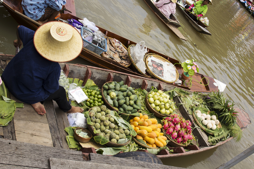 Tropical Frouit on boat of Floating Market in Thailand