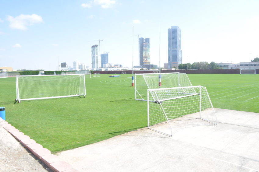 A glimpse of the football field at DC with a part of the Dubai skyline in the background.