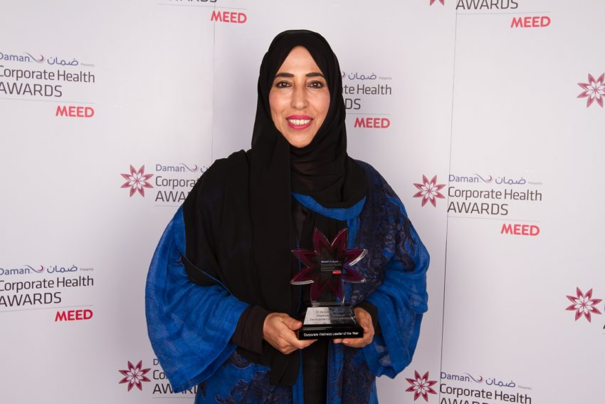 Ms Fatma Al Marri, CEO, KHDA receives the award on behalf of Dr Abdulla Al Karam.