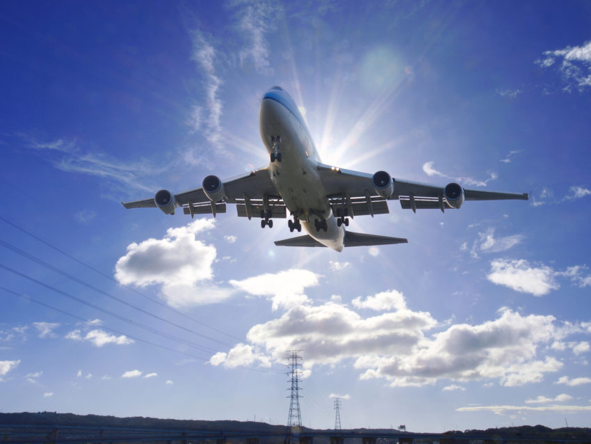 Airplane take off under sunlight in the airport